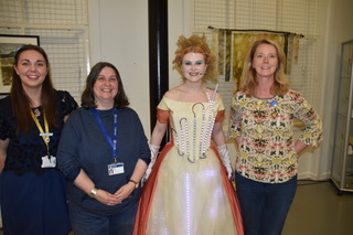 Actor dressed as Ada Lovelace stood with 3 adults