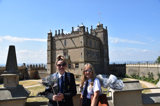 2 students sharing digital rose projects in front of Bolsover Castle