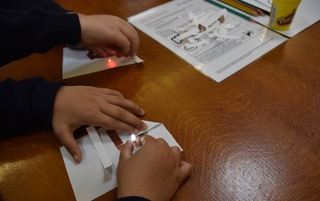 2 examples of leds lighting on a paper circuit