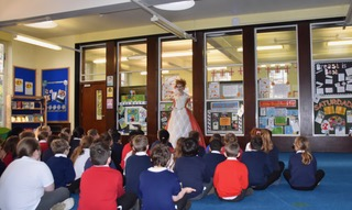 Actor performing as Ada Lovelace in front of a class of primary school children