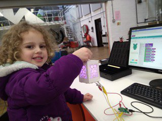 young child holding digital lantern project from manchester jam