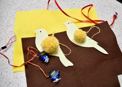 canary birds made out of pom poms and card